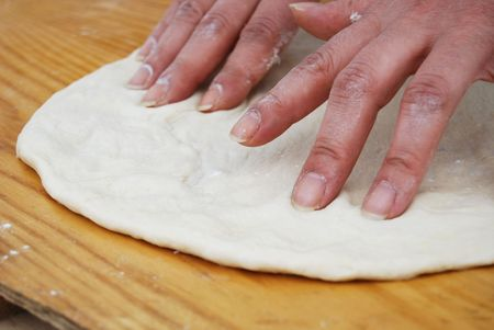 Hands and fingers that knead and streach pizza Stock Photo - 2736670