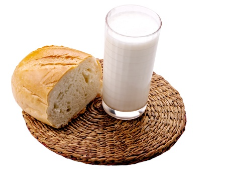glass of milk and a piece of bread photo