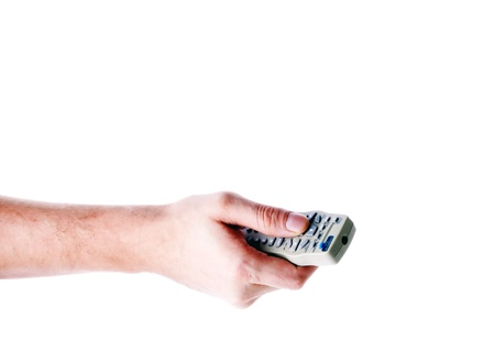 hand holding a remote control on a light background Stock Photo - 16449716