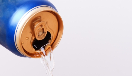 fluid flows from the open aluminum can Stock Photo - 16874260
