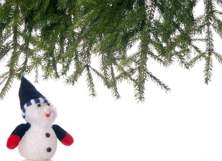 Snowman and spruce branches.background. photo