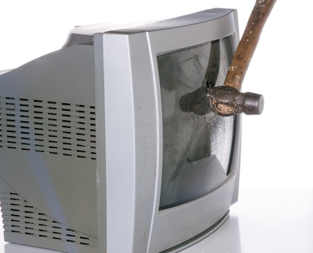 old TV screen smashed with a hammer photo