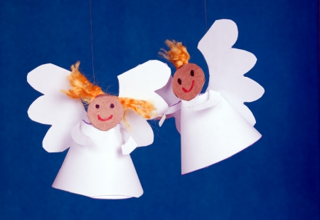 Two cheerful angels made from paper.