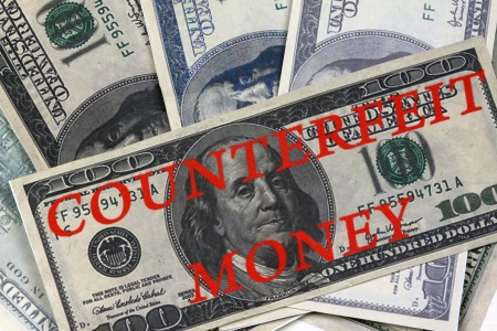 counterfeiting.printed on a color printer American hundred dollar bills.