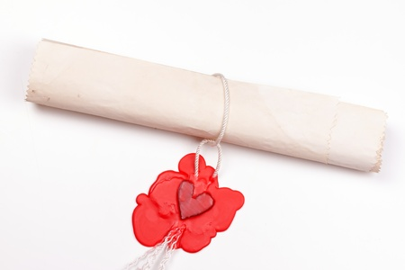 love letter sealed the seal in the form of heart in red sealing wax photo