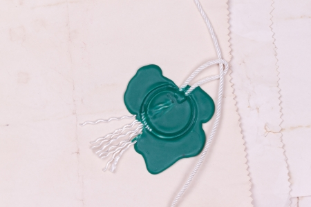 green print on the background of the old burnt paper.