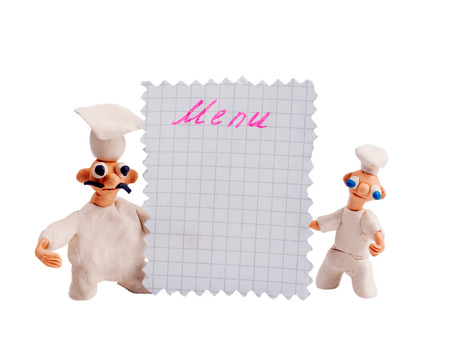 Two chefs from plasticine holding menu