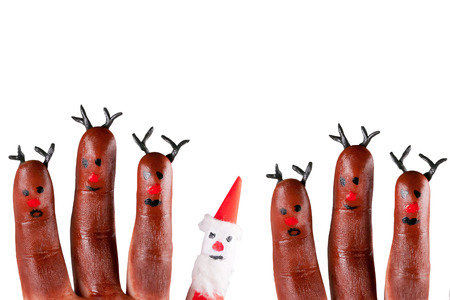 funny reindeer and Santa painted on fingers Banque d'images