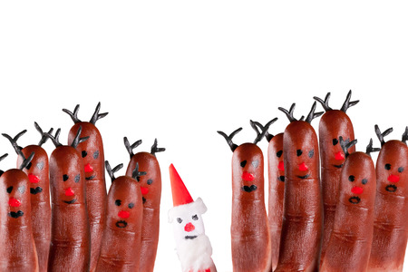 funny reindeer and Santa painted on fingers Banco de Imagens