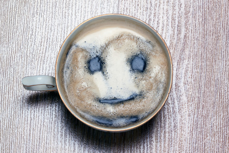 good morning  coffee cup with painted smiling face