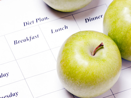 diet plan. green apples are on the diet plan, shallow depth of field. focus on the apple. Banco de Imagens