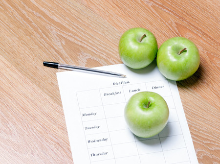 diet Plan. diet plan, pencil and apple lying on a wooden surface Banco de Imagens