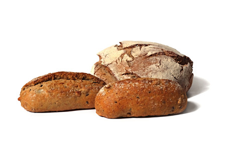 rustical: three rustical country style breads with seeds on white background Stock Photo