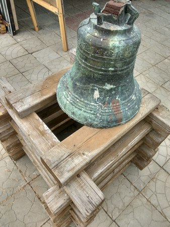 A close-up of a church bell in a temple in Russia.
