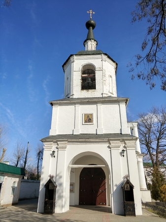 An old Russian church exterior over a blue sky on a bright sunny day