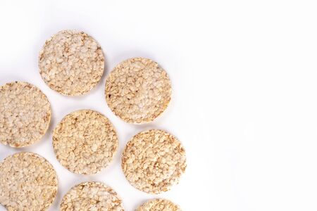 Puffed rice cakes on white background.