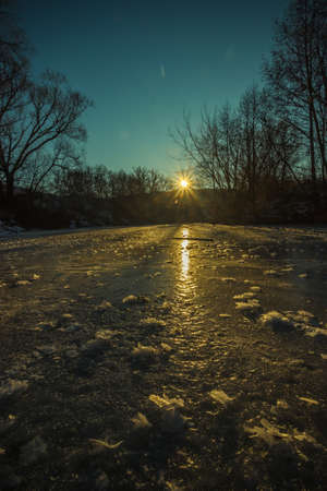 winter landscape on a frozen river in severe frost