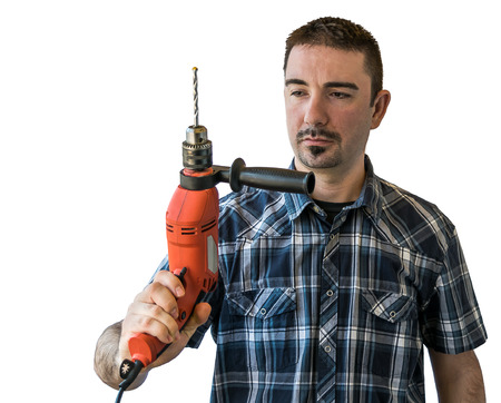 white trim: Young man in checkered shirt with trim beard in his 30s holding a red electric drill. Isolated on white background Stock Photo
