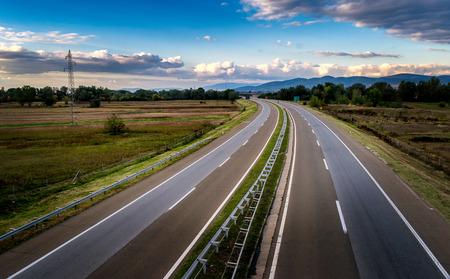 Empty open highway through pastoral landscape Stock Photo