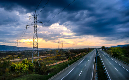 Silent Freeway and power line at dusk