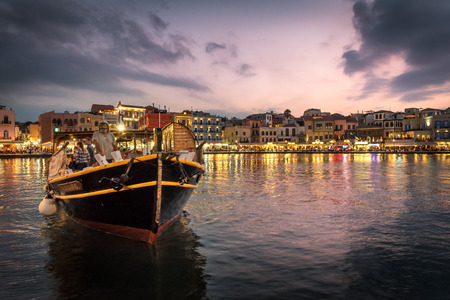 22nd August 2017: Chania, Crete, Greece. Dusk on the old Venetian harbor. The harbour dates back to ancient times and is now surrounded by restaurants, bars and shops and is very popular with tourists. Editorial