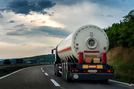 Tank truck on a  country highway or motorway Stock Photo