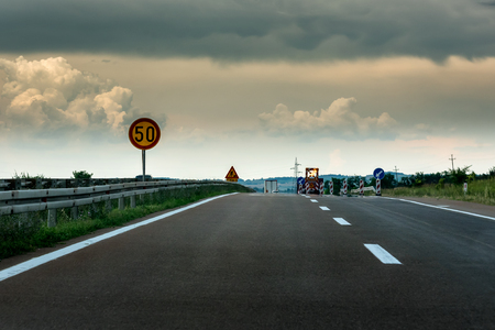 Highway constriction due to road repair with light traffic Editorial