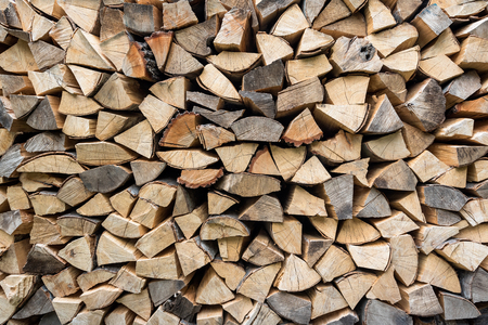 Dry chopped firewood logs ready for winter, Firewood wall background texture 写真素材