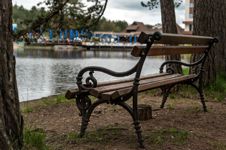Beautiful evening lake view with a park bench in Zlatibor, Serbia
