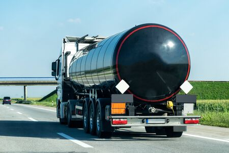 Tank truck on a rural country highway or motorway with light traffic Banco de Imagens
