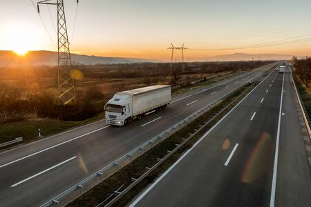 White Transportation Truck on summer country highway on a bright day