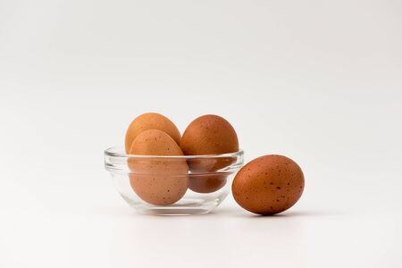Fresh egg glass bowl on the white background. Raw chicken eggs from the farm products natural eggs for food