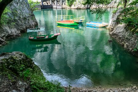 Old rugged and colorful boats docked in the small bay at Matka Canyon, Skopje, Macedonia