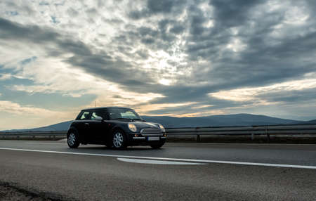 Belgrade, Serbia - February 21, 2020. Car traveling on a highway road on bright sunny sunset. Traveling by car concept Editorial