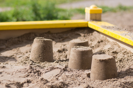 sandpit: Cakes in the sandbox, close-up Stock Photo