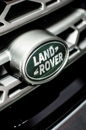 Minsk, Belarus May 2018 brand land-rover emblem logo sign on auto during autoexhibition on range rover land rover defender Editorial