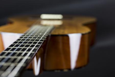Part Of A Orange Acoustic Guitar On Black Background Close Up