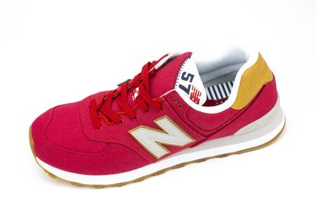 BOSTON, MA, USA, January 2019 - New Balance NB 574 athletic shoes on white background.