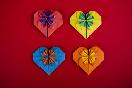 Concept of love handmade papercraft origami crafted colored paper heart close-up shot in studio 写真素材