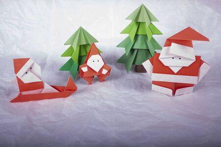 New Year card handmade origami figures. Christmas concept winter crafted decorations studio shot ISOLATED santa claus origami