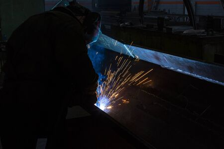 Industrial Worker at the factory welding closeup long exposure sparks 写真素材