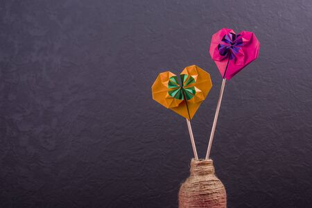 Concept of love handmade papercraft origami crafted colored paper hearts close-up shot in studio valentines day 写真素材