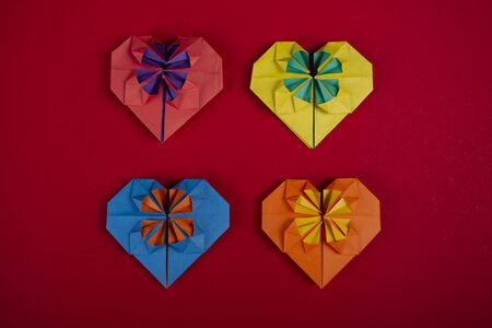 Concept of love handmade papercraft origami crafted colored paper hearts topshot close-up shot in studio 写真素材