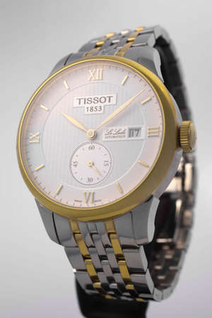Le Locle, Switzerland 15.01.2020 - Tissot man watch woman watch stainless steel case, gold PVD coating white clock face dial, metal bracelet, swiss quartz mechanical watch isolated, swiss made manufacture Sajtókép