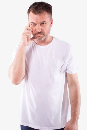 Attractive man with grey beard concentrating, hand on winkle. White background