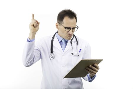 Disgruntled doctor holds thumb up looking on clipboard with patients diagnosis Imagens