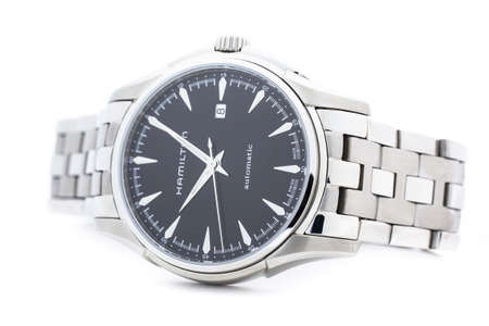 Biel, Switzerland 31.03.2020 - The close up of Hamilton man watch stainless steel case black clock face dial stainless steel bracelet swiss quartz mechanical watch isolated lying on table swiss made manufacture Redakční