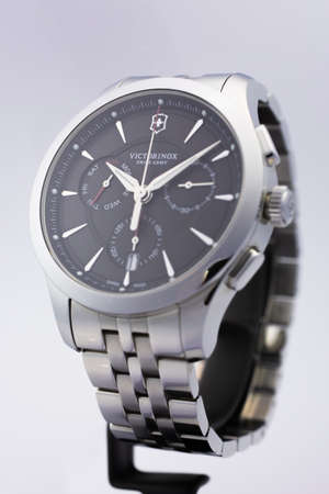 Ibach, Switzerland 31.03.2020 - The close up of Victorinox man watch stainless steel case stainless steel bracelet black clock face dial swiss quartz mechanical watch swiss made manufacture isolated on stand Sajtókép