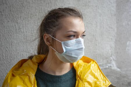 Caucasian girl infected with ncov-2019 virus in a protective medical mask