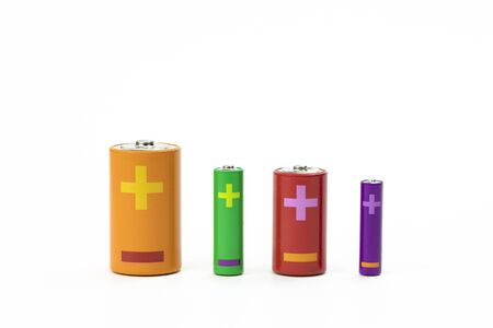 Four colorful batteries of different sizes isolated on white. Recycling concept